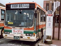 Bus bound for Kutoyama leaving in front of Hamasaka station.